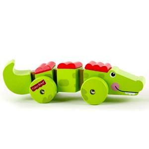 Cocodrilo articulado sobre ruedas juguete de madera para bebés a partir de 2 años de Fisher-Price